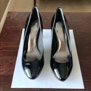 Coach High-heeled patent black leather shoes